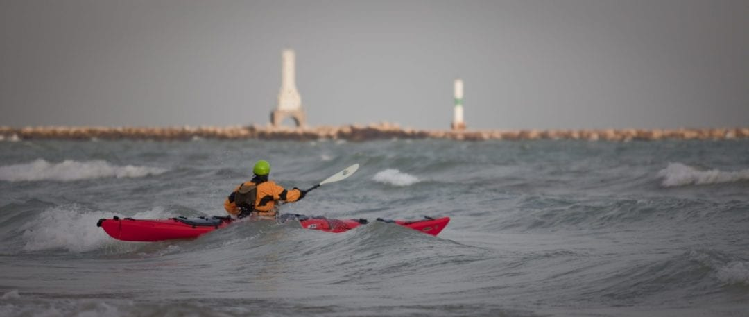 Pwerson kayaking in the Great Lakes Wisconsin Harbor Towns
